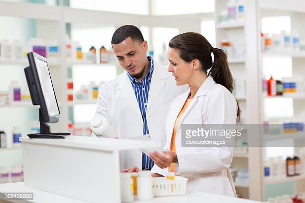 Two Pharmacists filling Prescription