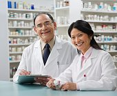 Two pharmacists in pharmacy