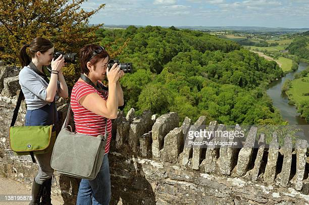 Two photographers taking pictures from a raised viewpoint in the Forest of Dean taken on May 31 2011