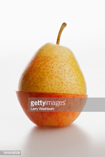 Two pieces of different fruit stacked to comprise the shape of a piece of fruit