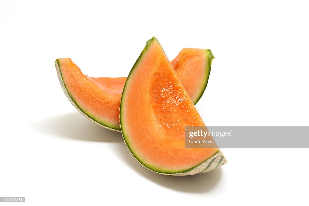two pieces of fresh cantaloupe