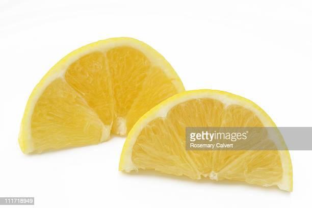 Two pieces of fresh juicy lemon.