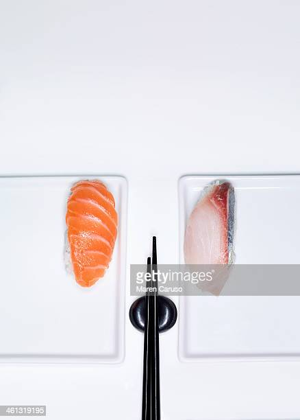 Two Pieces of Nigiri Sushi Plated with Chopsticks