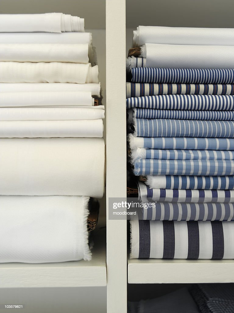 Two piles of cotton towels on shelf : Stock Photo