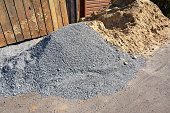 Two piles of gravel and sand at industrial site. Building materials on the construction site.