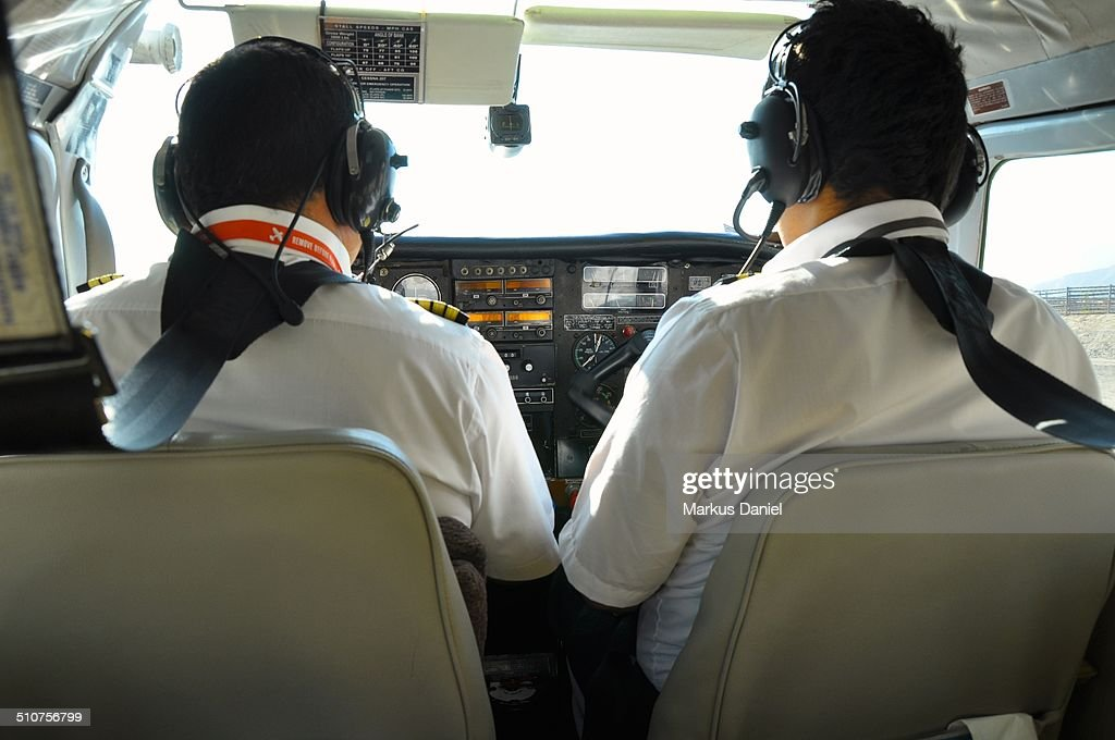 Two pilots in a small propeller plane