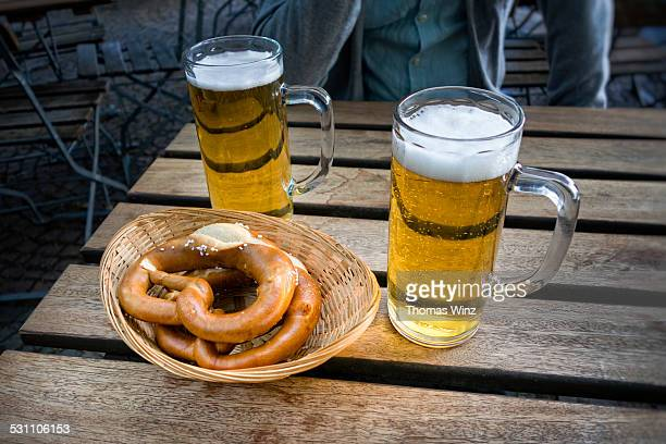 Two pints of beer and soft pretzels
