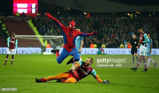 Two pitch invaders one dressed as Spiderman run onto the pitch during the Emirates FA Cup Third Round match between West Ham United and Manchester...