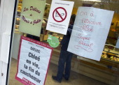 Two placards reading 'Chloe alive the end of a nightmare' and 'Chloe has been found Great' are seen on a window shop in Barjac southern France on...