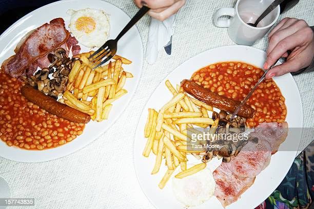 two plates of full english breakfast