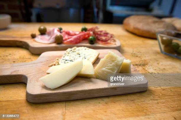 Two Plates with Ham, Salami and Prosciutto and Cheese