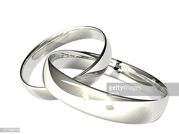 Two Platinum or Silver Wedding Rings - Reflected Candles