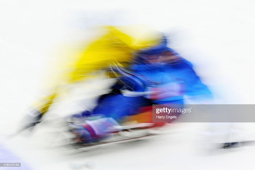 Two players clash during the Ice Sledge Hockey Classification match between Italy and Sweden at the Shayba Arena during day five of the 2014...