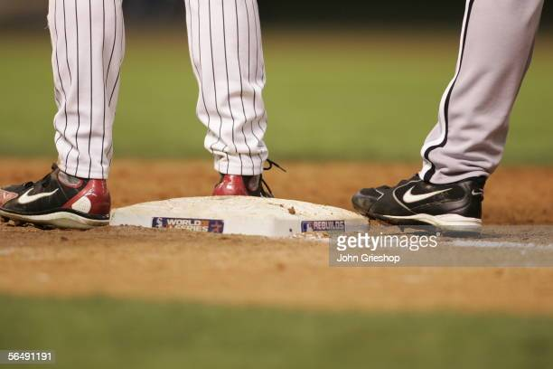 Two players stand near first base during Game Three of the Major League Baseball World Series against the Houston Astros at Minute Maid Park on...