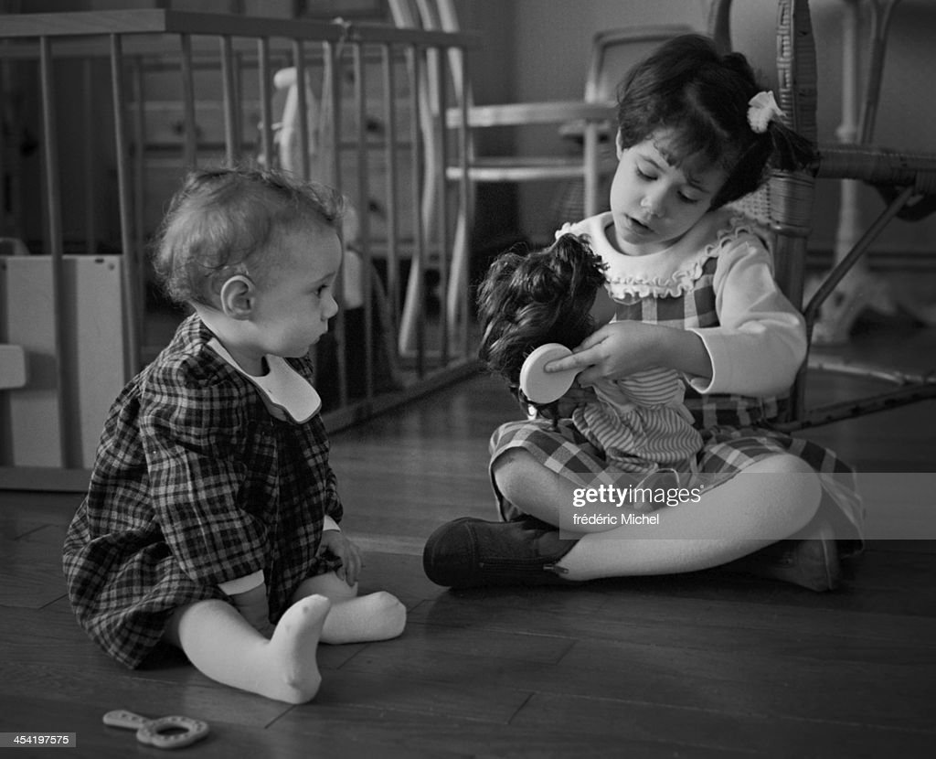 Two playing with dolls girls : Stock Photo