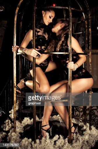 Two pole dancers at a nightclub