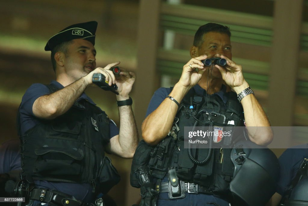 Two police agents monitoring the Nice supporters stands during the UEFA Champions League Qualifying Play-Offs round, second leg match, between OGC Nice and SSC Napoli at Allianz Riviera Stadium on August 22, 2017 in Nice, France.