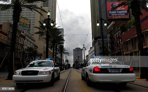 Two police cars are in position on an nearly empty Canal Street after most of the city evacuated as hurricane Gustav approaches August 2008 in New...