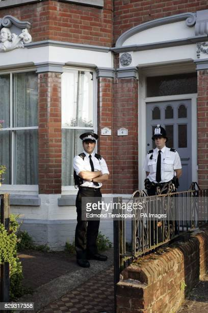 Two police officers stand guard outside 4 Kenilworth Road in the Polygon area of Southampton after their antiterrorist operation Avon earlier in the...