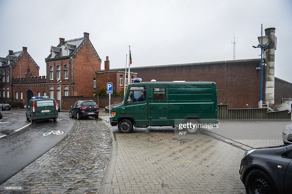 Two police vans leave the Nivelles jail, on February 4, 2013 where convicted Belgian serial killer Marc Dutroux is being held. Dutroux is to appear before the execution court in the Brussels' justice palace after requesting electronic home arrest after being convicted of life imprisonment. Three victims of Dutroux have filed a complaint before the European Court of Human Rights (CEDH) in Strasbourg to protest against the Belgian procedure of conditional release. AFP PHOTO/BELGA /LAURIE DIEFFEMBACQ