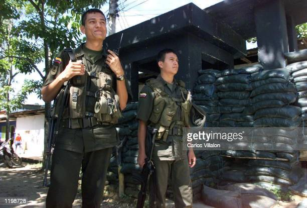 Two policemen guard the streets of San Vicente del Caguan on August 1 2002 The town after peace dialogues between the government and the...