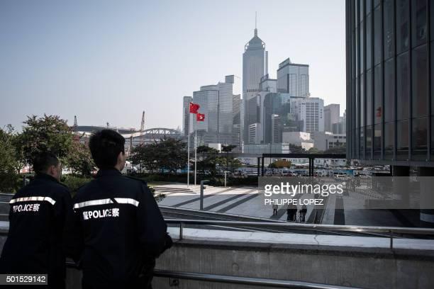 Two policemen keep vigil outside the Legislative Council building in Hong Kong on December 16 2015 Hong Kong lawmakers were to begin debating over...