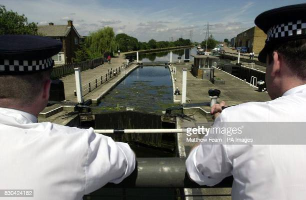 Two policemen overlook Tottenham Lock on the River Lea in Tottenham north London where police looking for Andrea Auriglietti recovered a body of a...