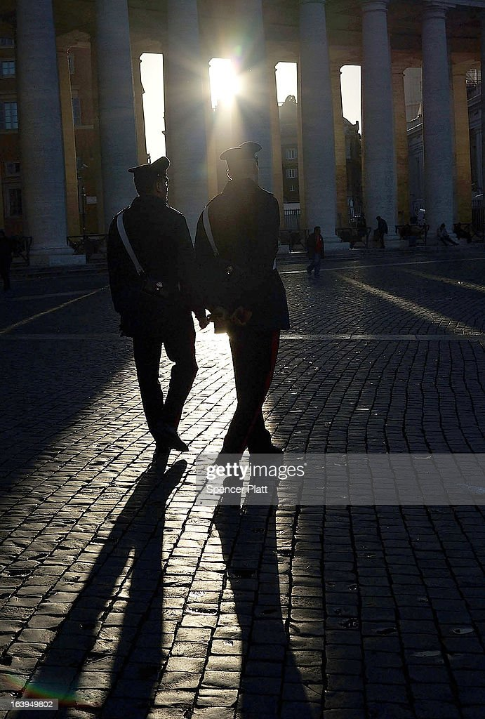 Two policemen walk through St Peter's Square as workers prepare for the inauguration mass of Pope Francis on March 18, 2013 in Vatican City, Vatican. The Inauguration Mass for Pope Francis will take place on March 19, the feast day for St. Joseph.
