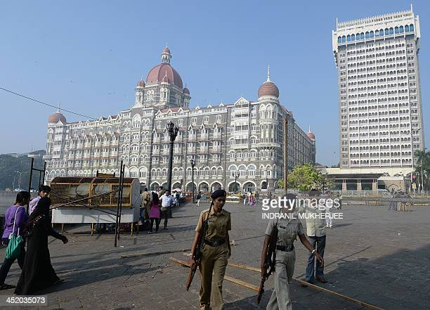 Two policewomen walk past the promenade outside the iconic Taj Mahal Palace and hotel on the fifth anniversary of the 2008 attacks in Mumbai on...