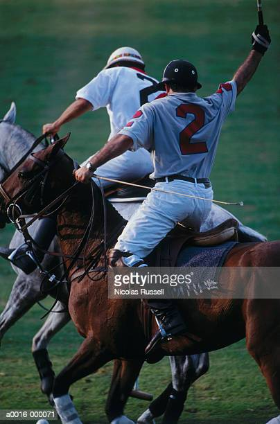 Two Polo Players on Field