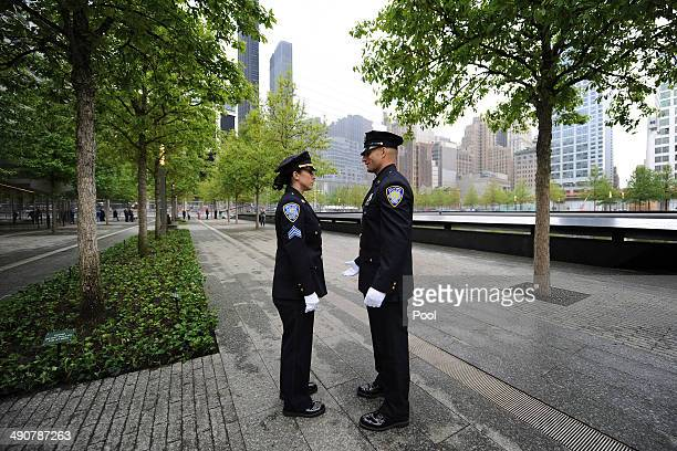 Two Port Authority Police Officers talk before the start of the dedication ceremony at the National September 11 Memorial Museum at ground zero May...