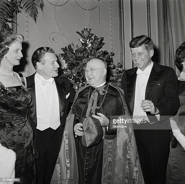 Two potential presidential rivals New York Governor Nelson Rockfeller and Senator John F Kennedy chat amiably with New York's Francis Cardinal...