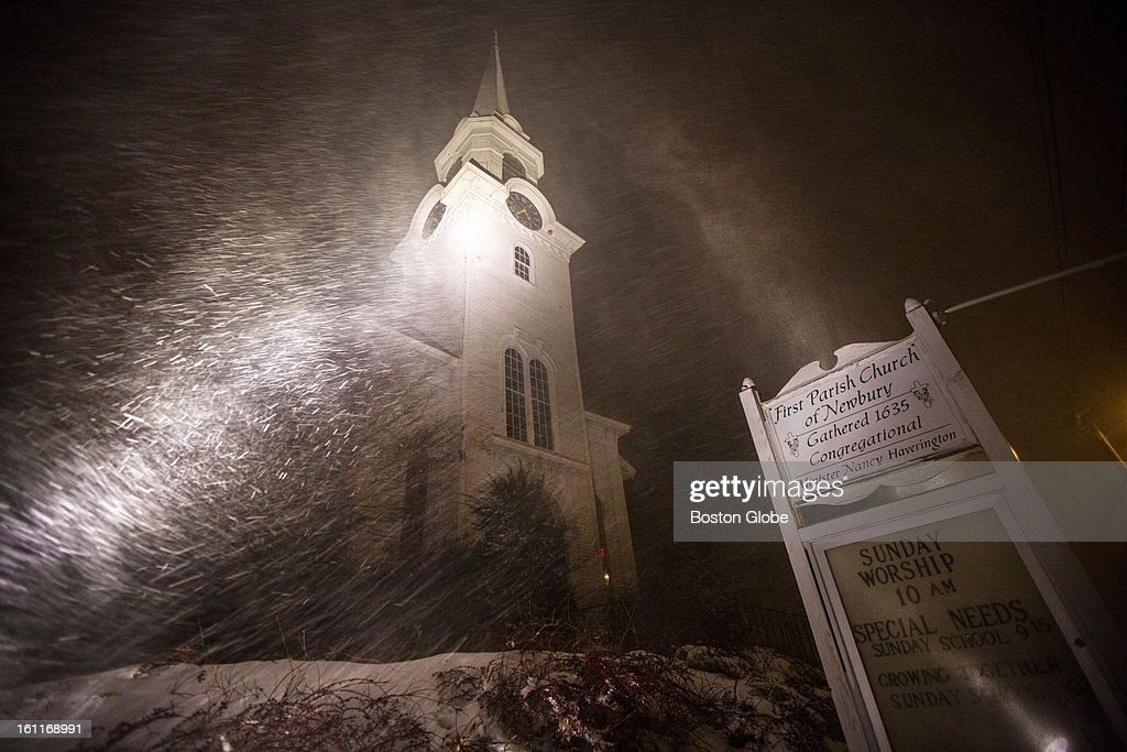 Two powerful lights illuminate First Parish Church of Newbury as a winter storm, expected to dump as much as 24 inches of snow in the region, intensified in Newbury.