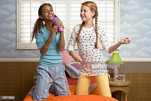 Two preteen girls singing