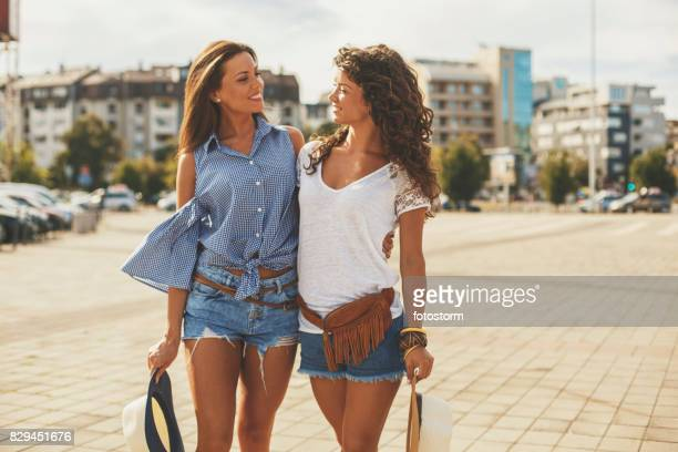 Two pretty girls on city street