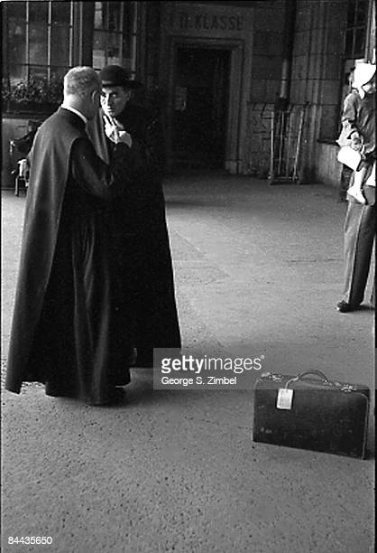 Two priests chat while waiting at the Termini train station in Rome 1953