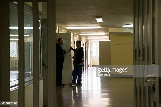 Two prisoner chat in a corridor inside the Justizvollzugsanstalt Ploetzensee state prison in Berlin Germany on October 14 2016 Almost one third of...