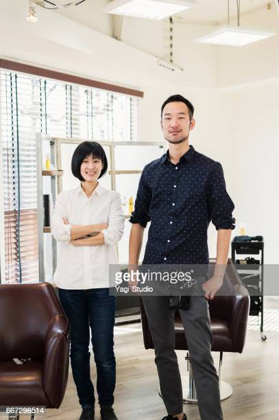 Two professional hair stylist owners working in hair salon