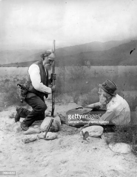 Two prospectors panning for gold in California