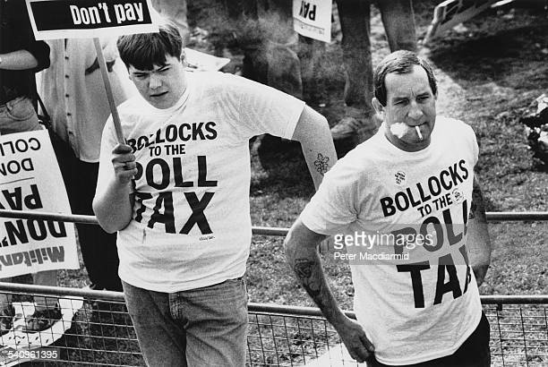 Two protestors with 'Bollocks to the Poll Tax' tshirts in Kennington during the Poll Tax Riots in London 31st March 1990