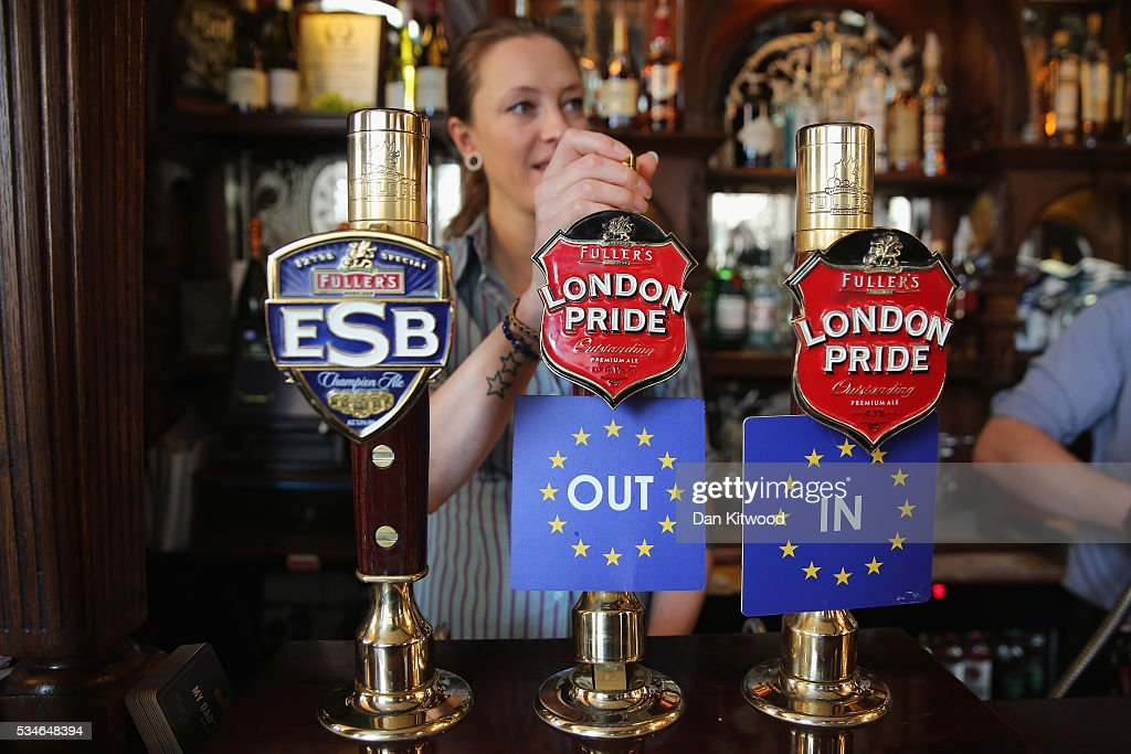 Two pumps of Fuller's London Pride are branded with 'IN' and 'OUT' labels in the Red Lion Pub in Westminster on May 27, 2016 in London, England. The United Kingdom will hold a referendum on June 23, 2016 to decide whether or not to remain a member of the European Union (EU), an economic and political partnership involving 28 European countries, which allows members to trade together in a single market and provide free movement across it's borders for cirtizens.
