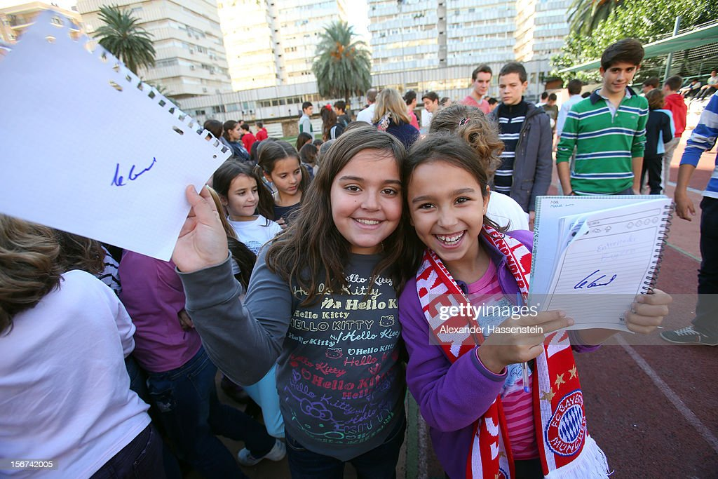 Two pupils showing their autograph of Uli Hoeness, President of Bayern Muenchen at the German School Valencia on November 20, 2012 in Valencia, Spain.