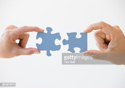 Two Puzzle Pieces Coming Together : Foto de stock