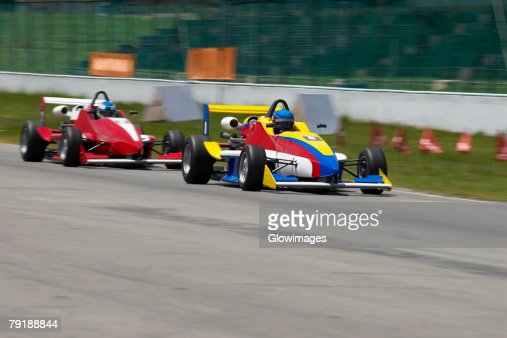 Two racecars racing on a motor racing track : Foto de stock