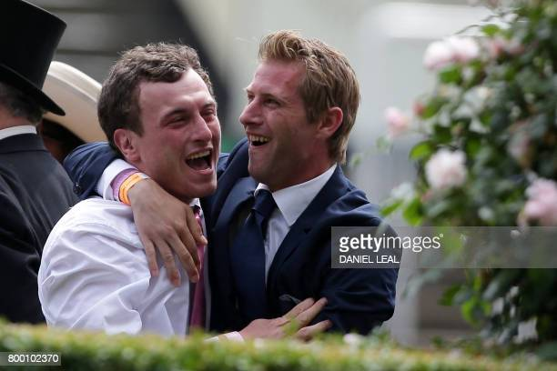 Two racegoers celebrate picking a winner in the first race on the fourth day of the Royal Ascot horse racing meet in Ascot west of London on June 23...