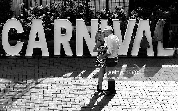 Two racegoers kiss after Oaks Day at Flemington Racecourse on November 5 2015 in Melbourne Australia