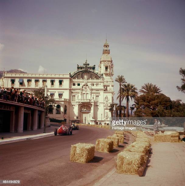 Two racing cars taking a bend Monaco Grand Prix Monte Carlo 1959 The car in front is number 50 a Ferrari D246 driven by Tony Brooks Brooks eventually...