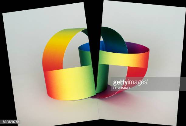 Two rainbow colored rings simultaneously connected and separated.