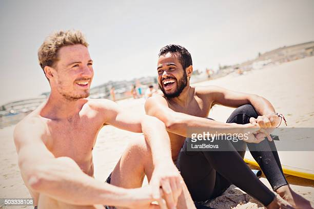 Two real mixed race friends at Bondi Beach, Australia