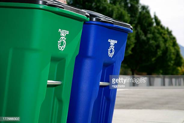 Two recycling bins placed outside